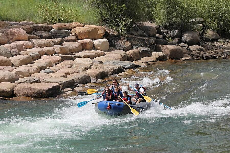 Sam whitewater rafting with his family